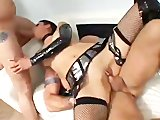 Brunette tied up and fucked by two juicy cocks